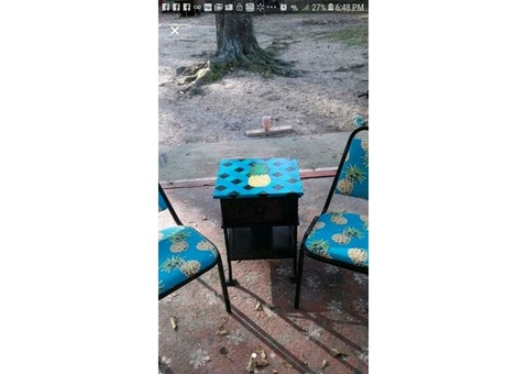 pineapple table and 2 chairs